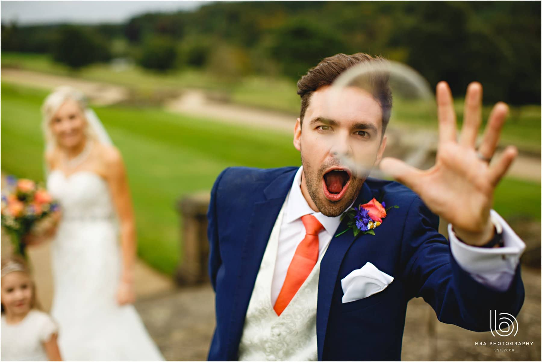 the groom chasing a bubble