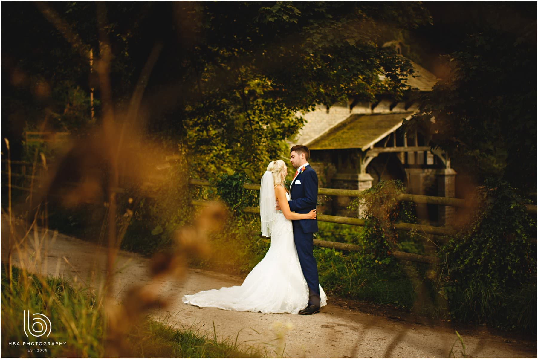 the bride and groom at the water mill