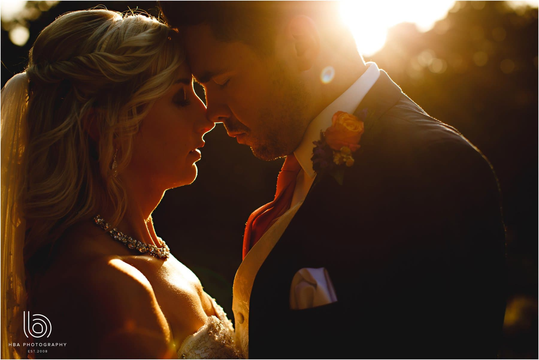 the bride and groom in golden hour