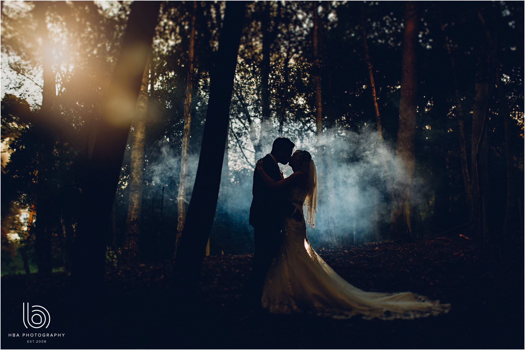 the bride and groom in the mist