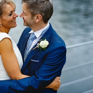 the bride and groom stood by the river at The West Mill in derby