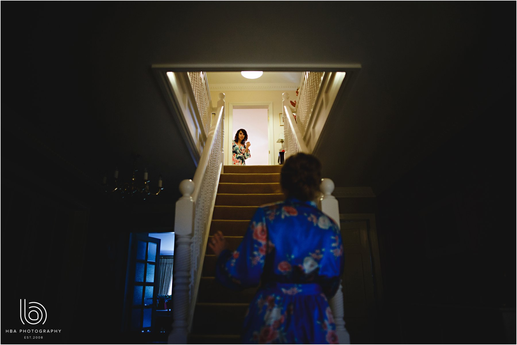 Bride looking down the stairs