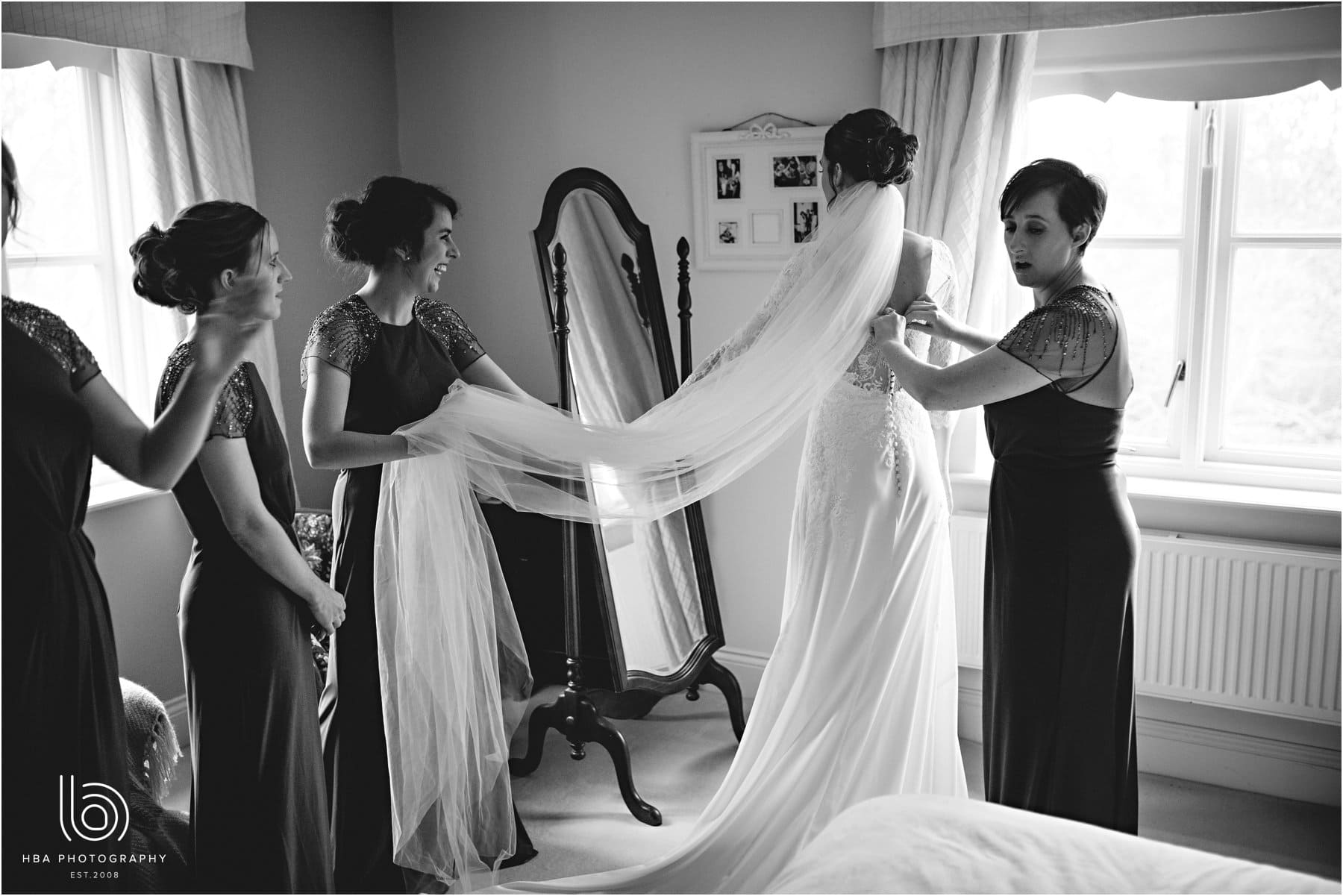 the bride putting her veil in