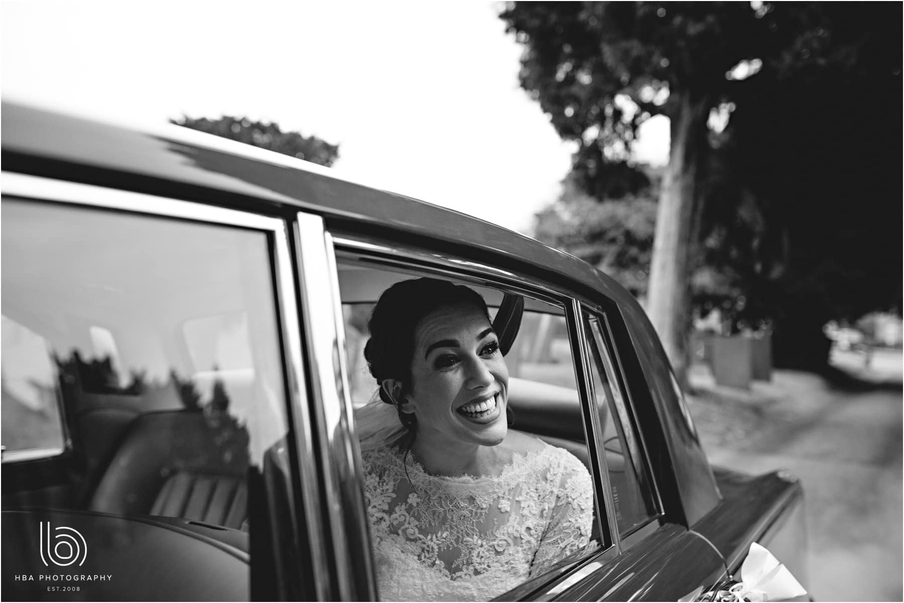 the bride looking out the car window
