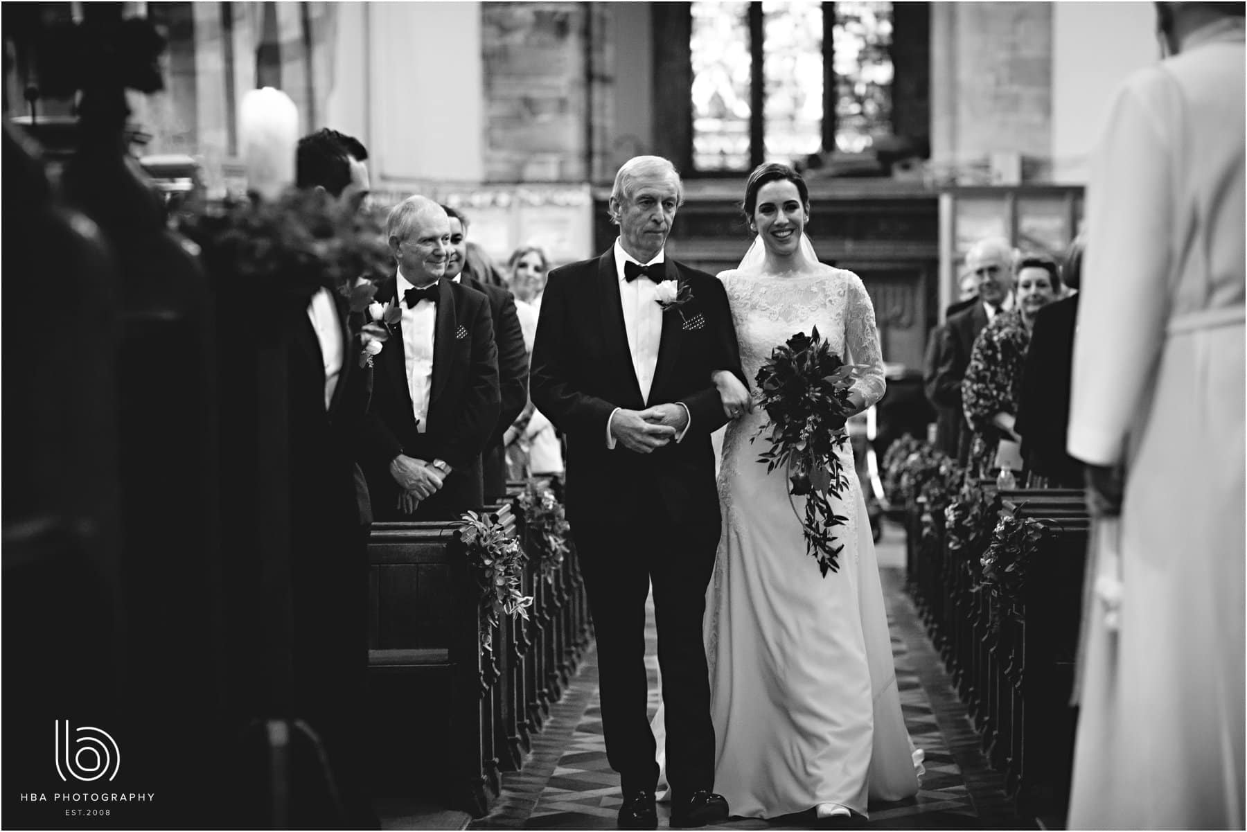 the bride and her father walking down the aisle