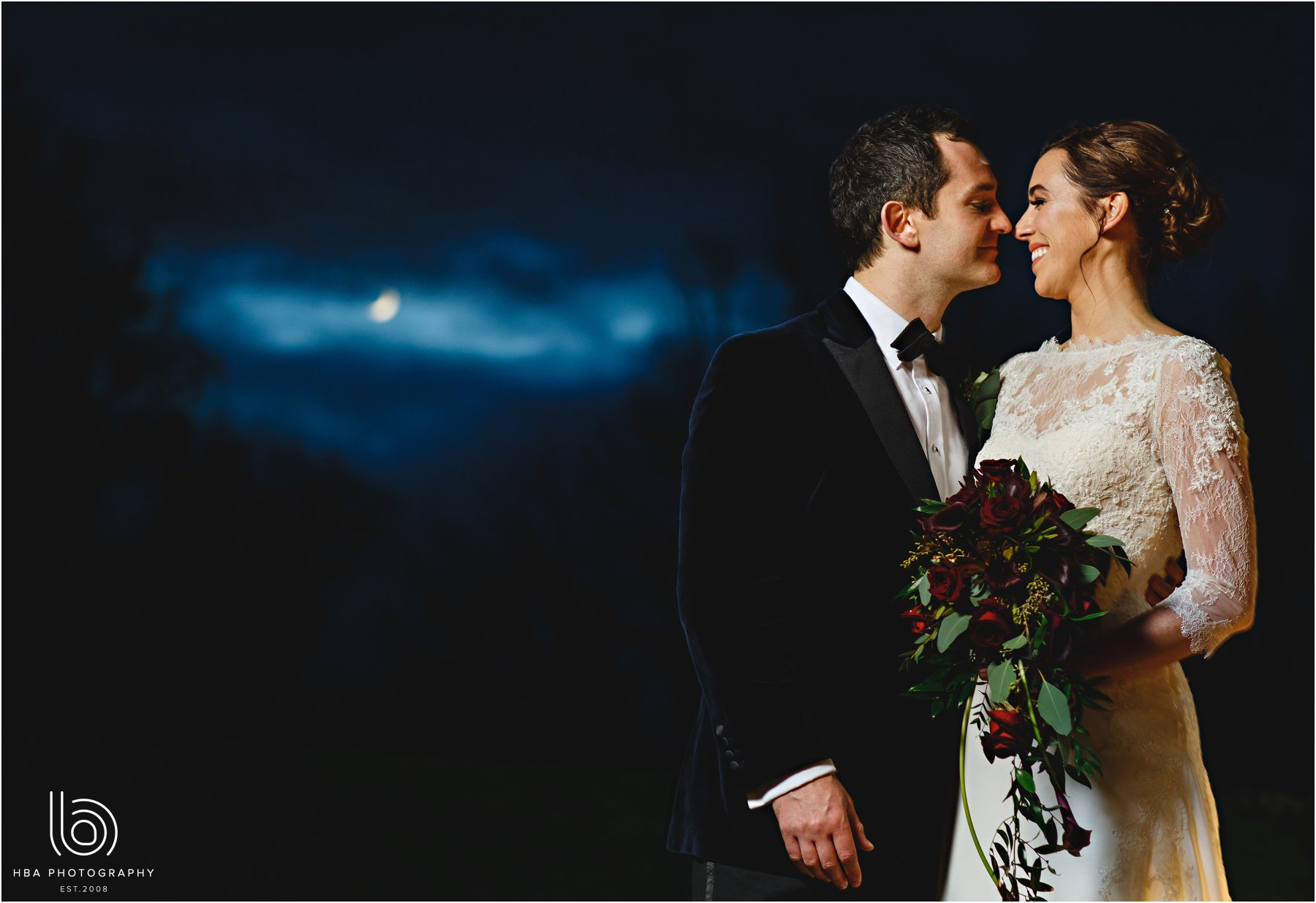 the bride and groom in the moonlight