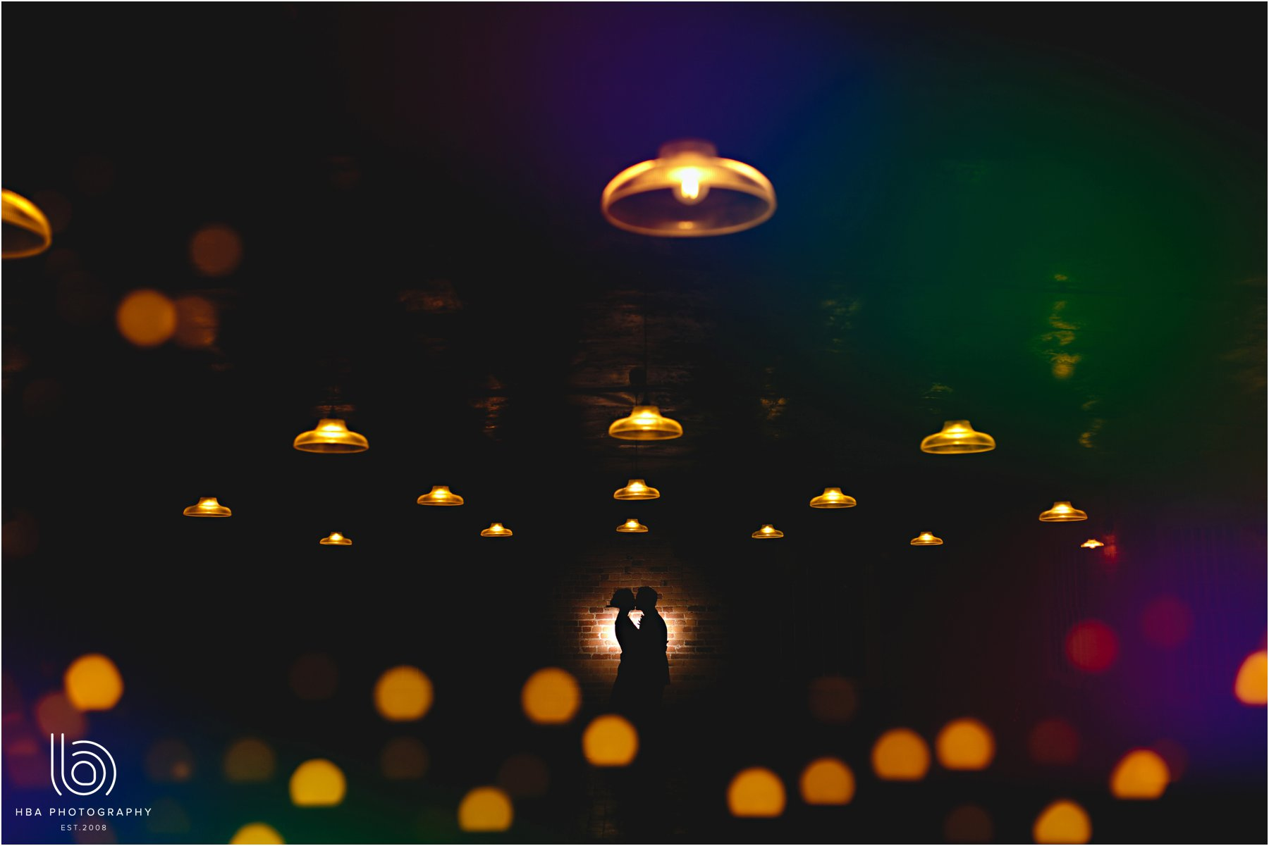 the bride and groom with lights