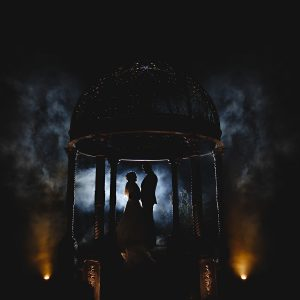 the bride and groom stood in dark smoke at Swancar Farm Country House