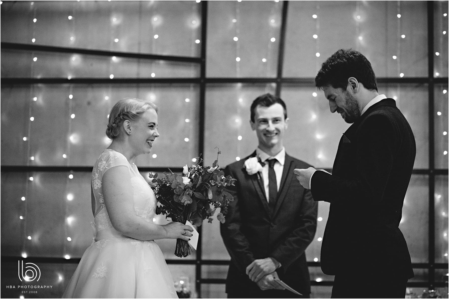 The bride and groom saying thier vows in black-and-white