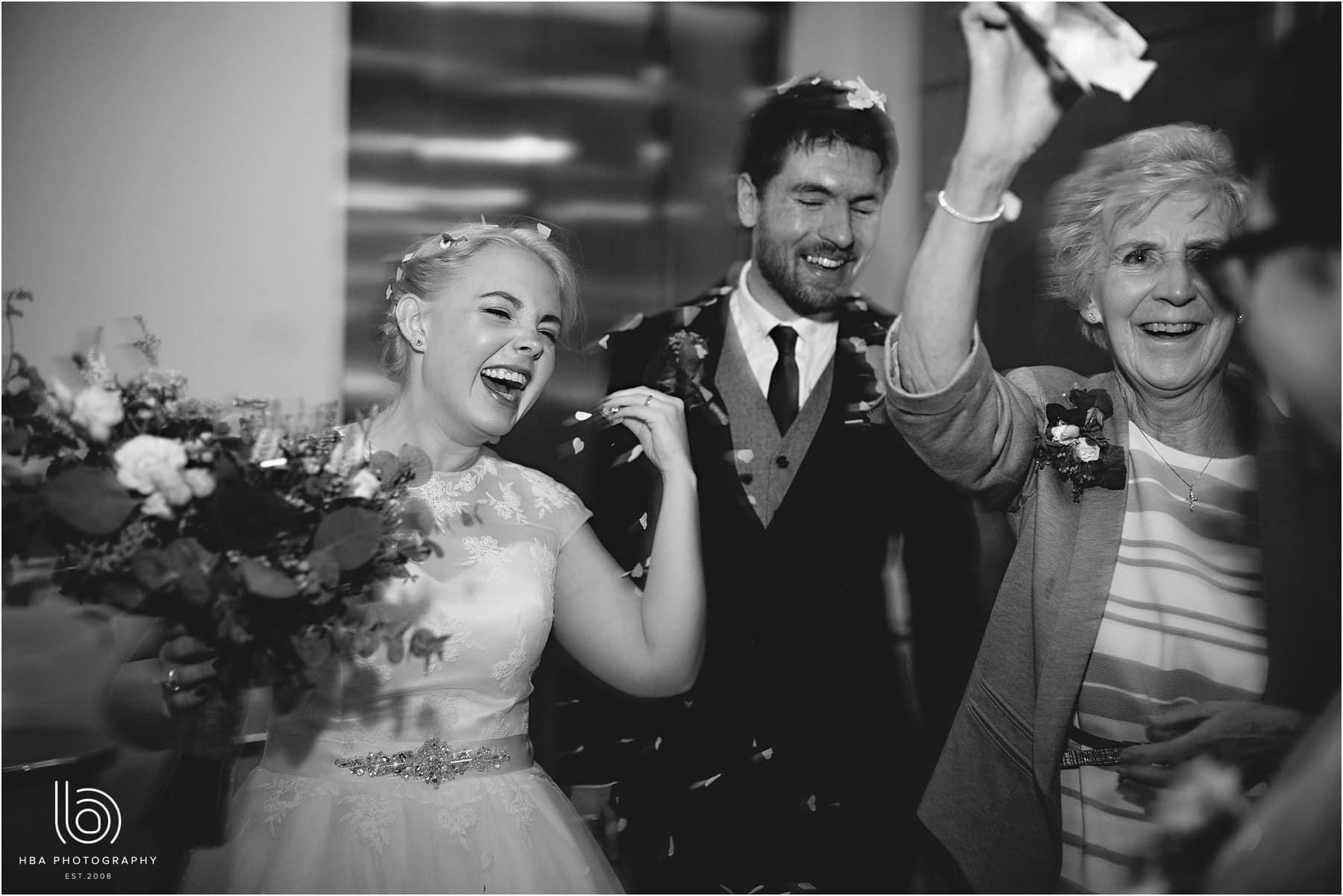 Grandma throwing confetti in black-and-white
