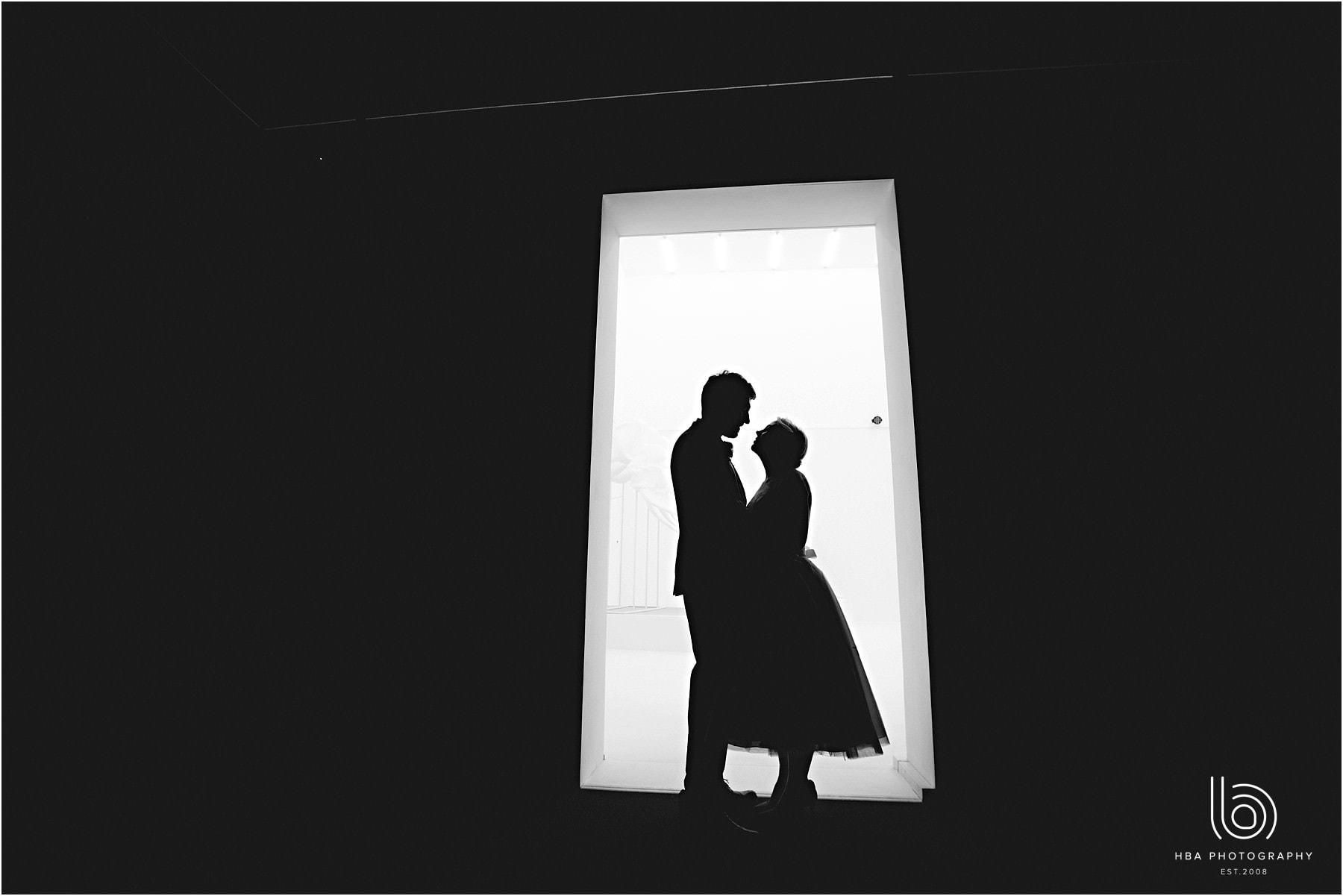 The bride and groom in silhouette looking at each other