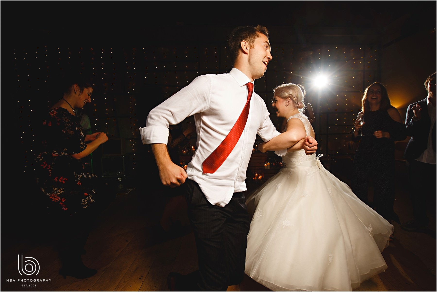 The bride dancing with friends at her wedding