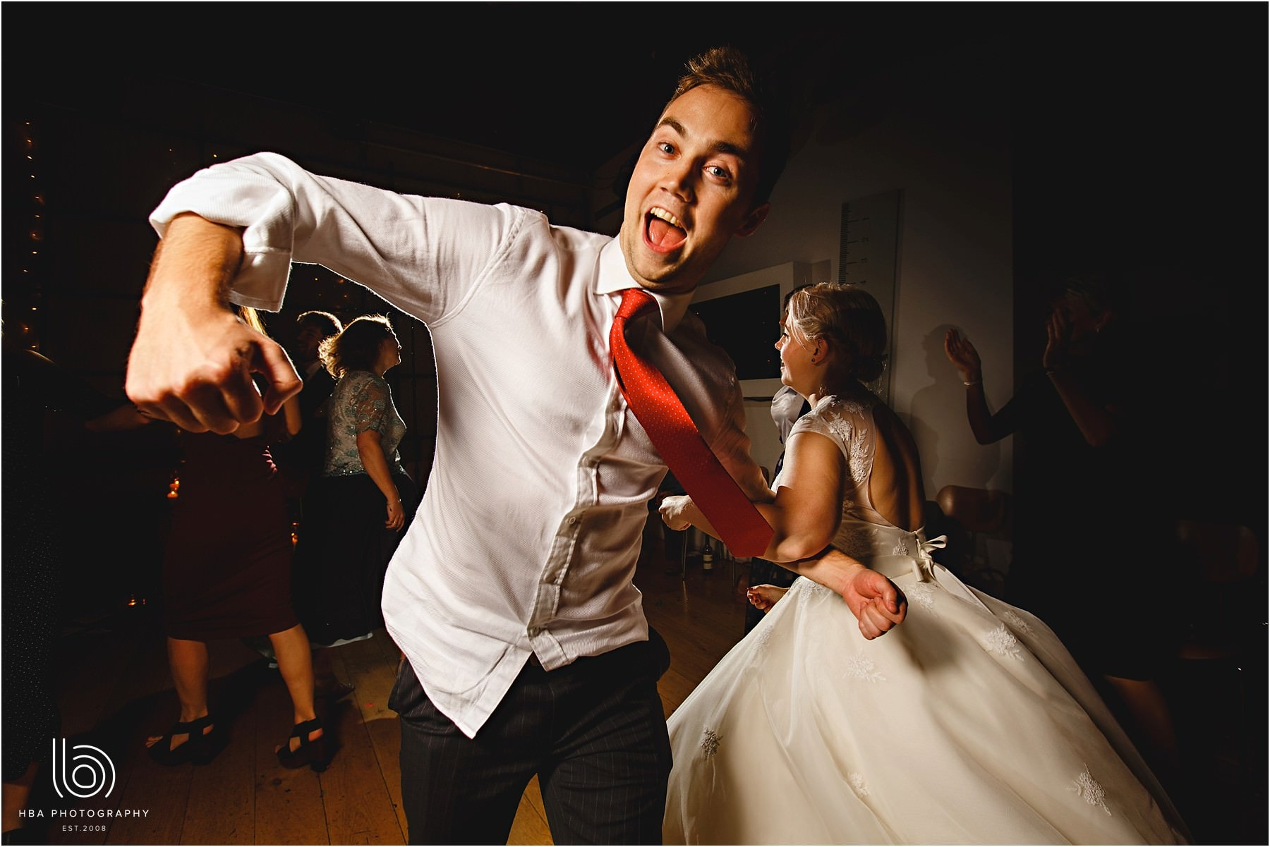A guy with a red tie dancing