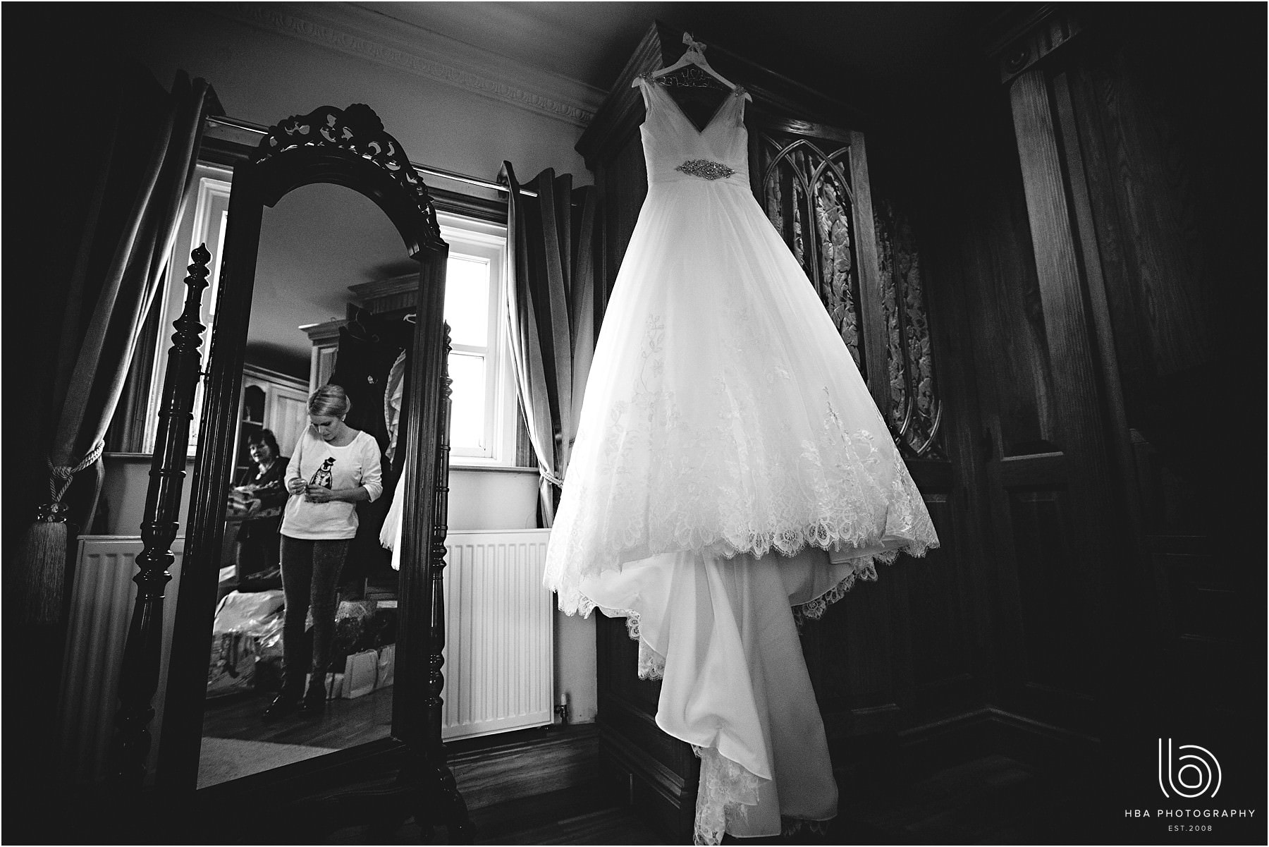 The wedding dress hanging up in black-and-white