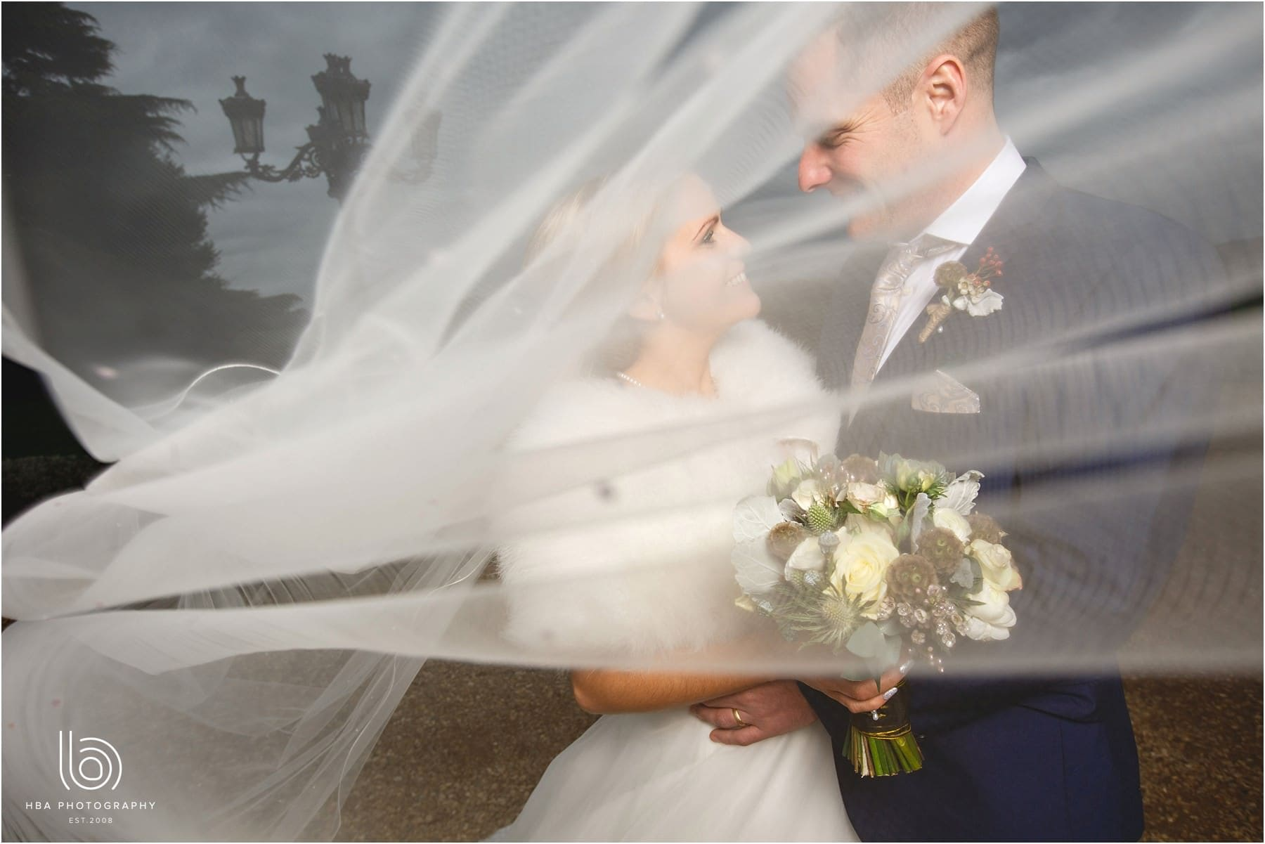 The bride and groom holding flowers