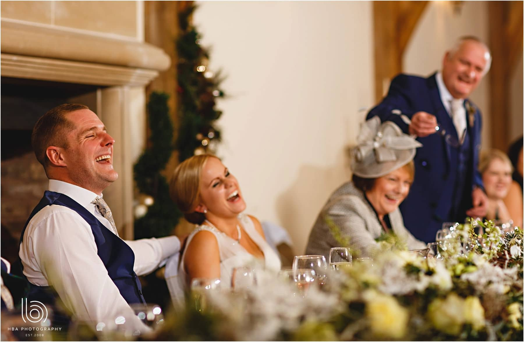 The bride and groom laughing at dads speech