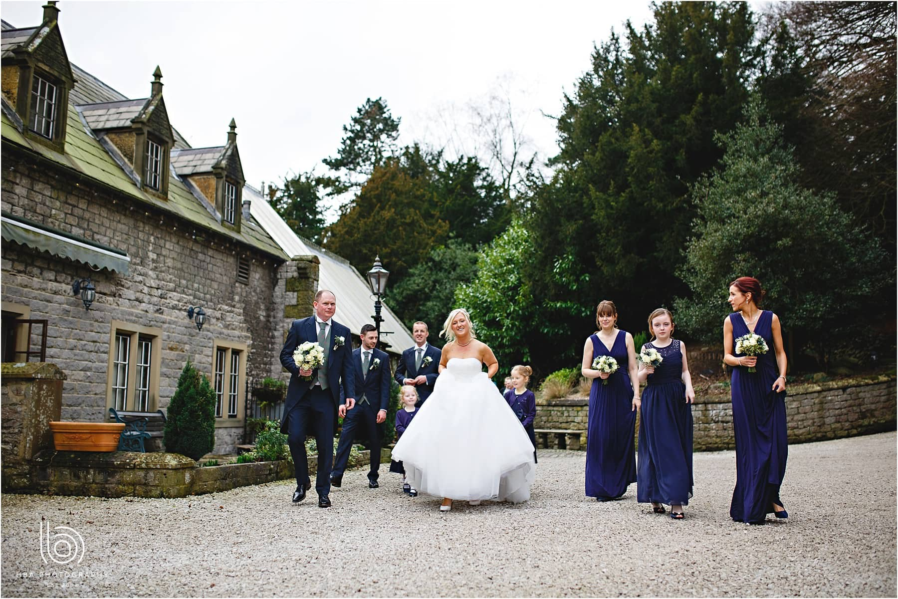 The bride and the bridal party outside at Cressbrook Hall