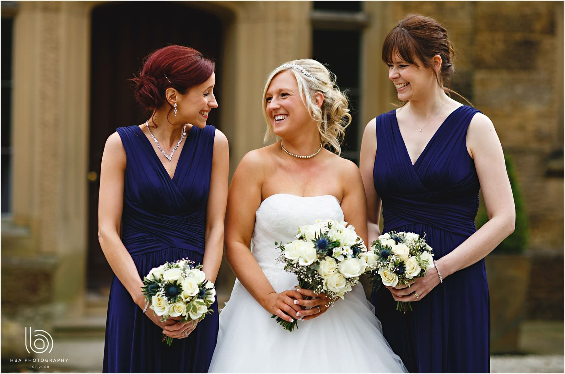 The bride and the bridesmaids in blue