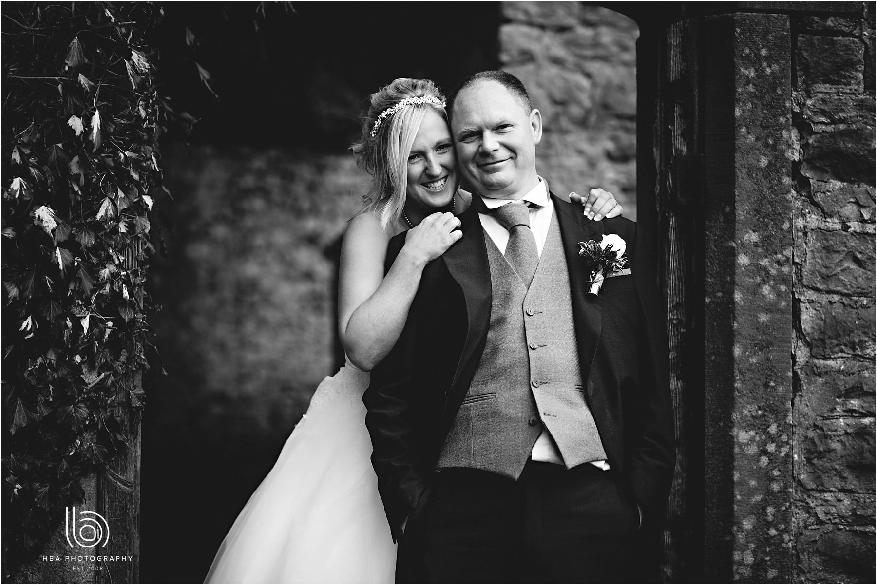 The bride and groom looking happy