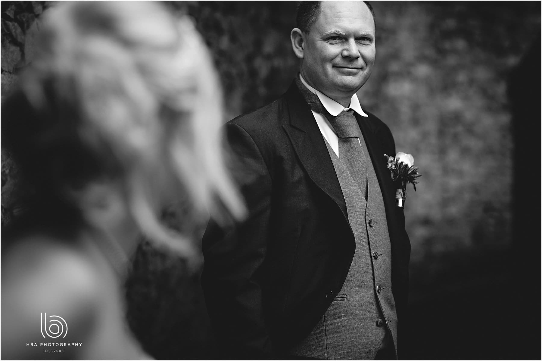 Portrait of the groom in black-and-white