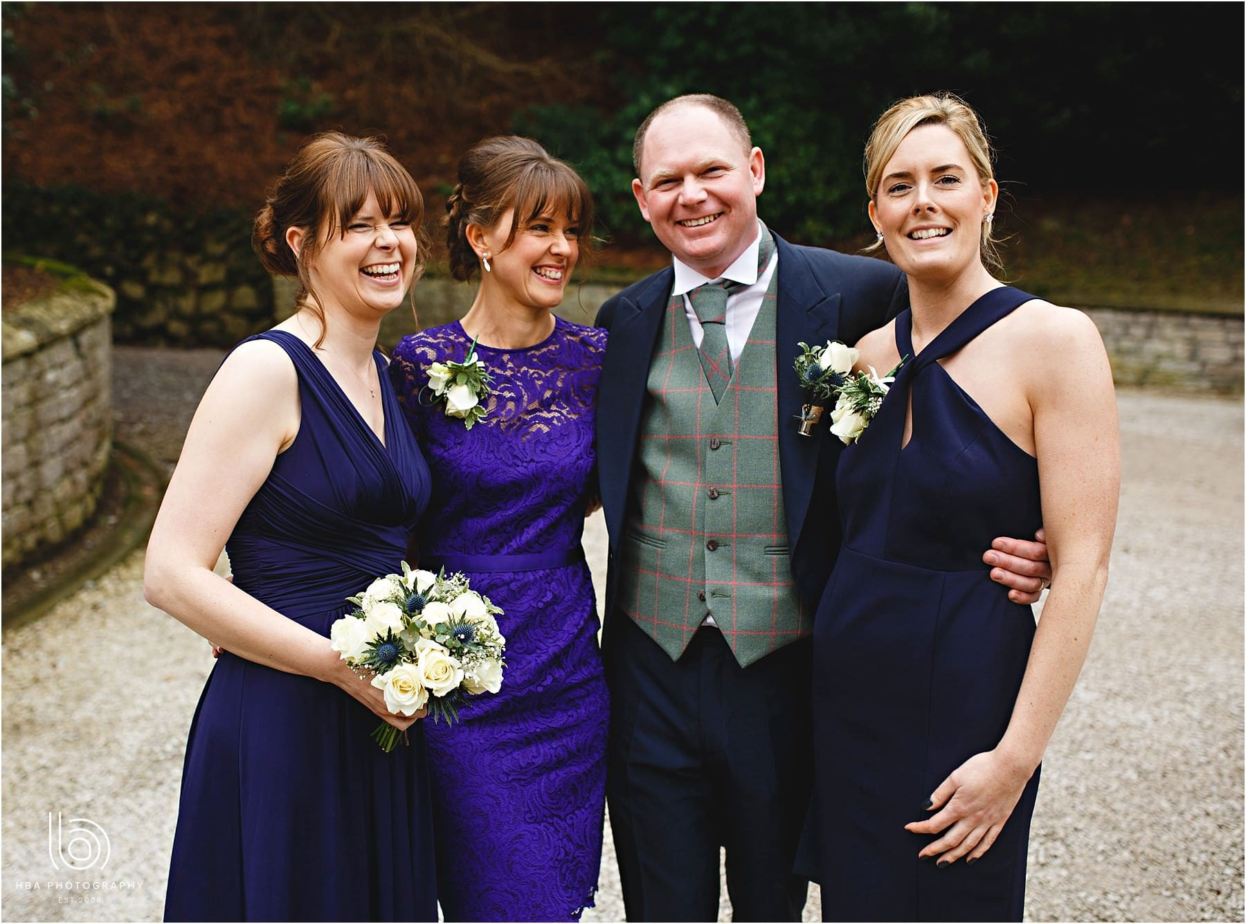 Dad and his daughters together at the wedding