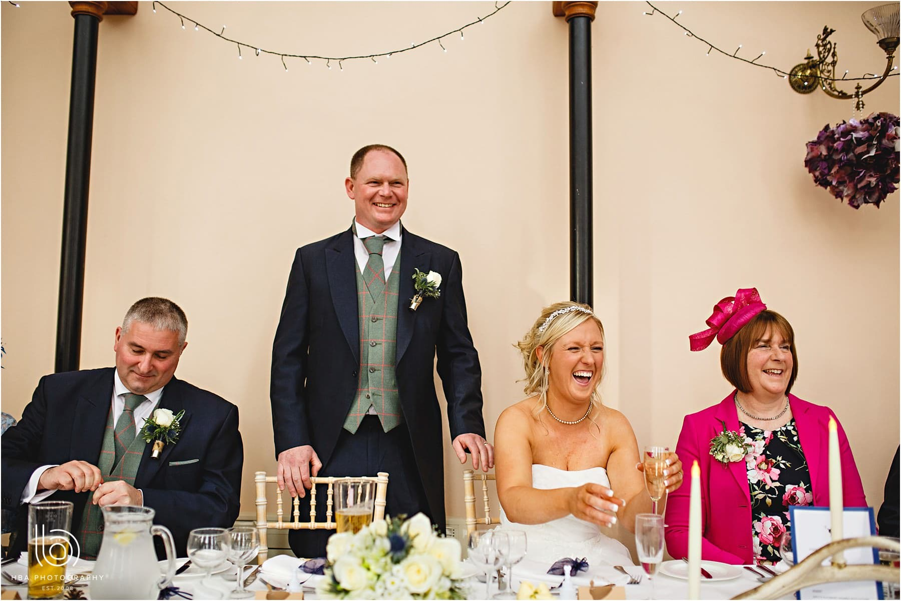 Laughing at the grooms speech