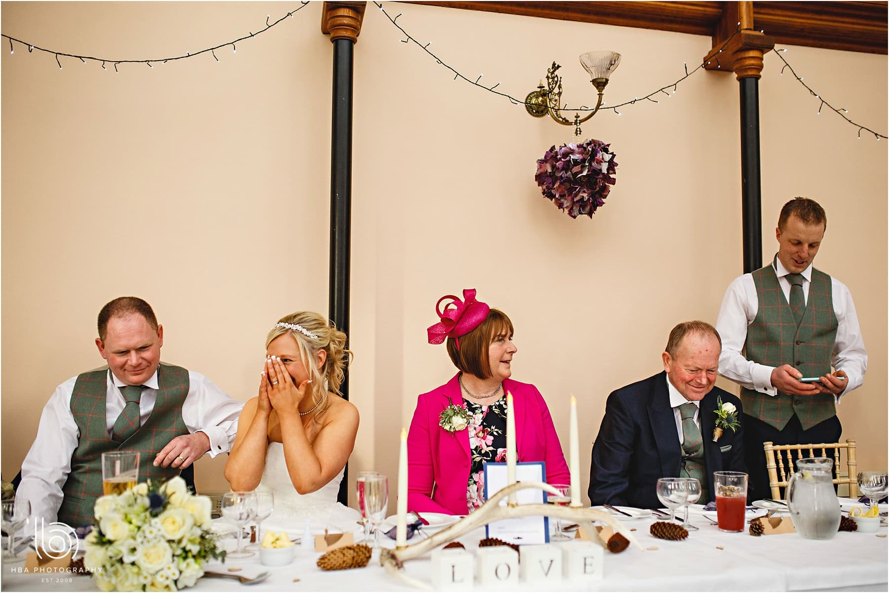 Laughing at the best man's speech