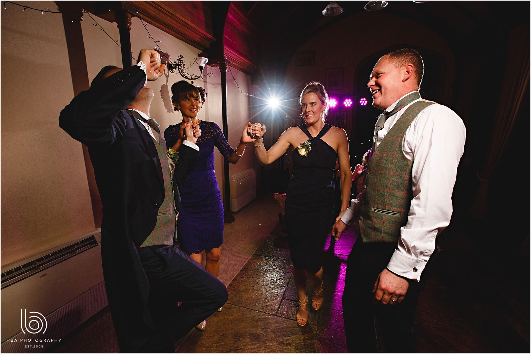 Wedding guests dancing together