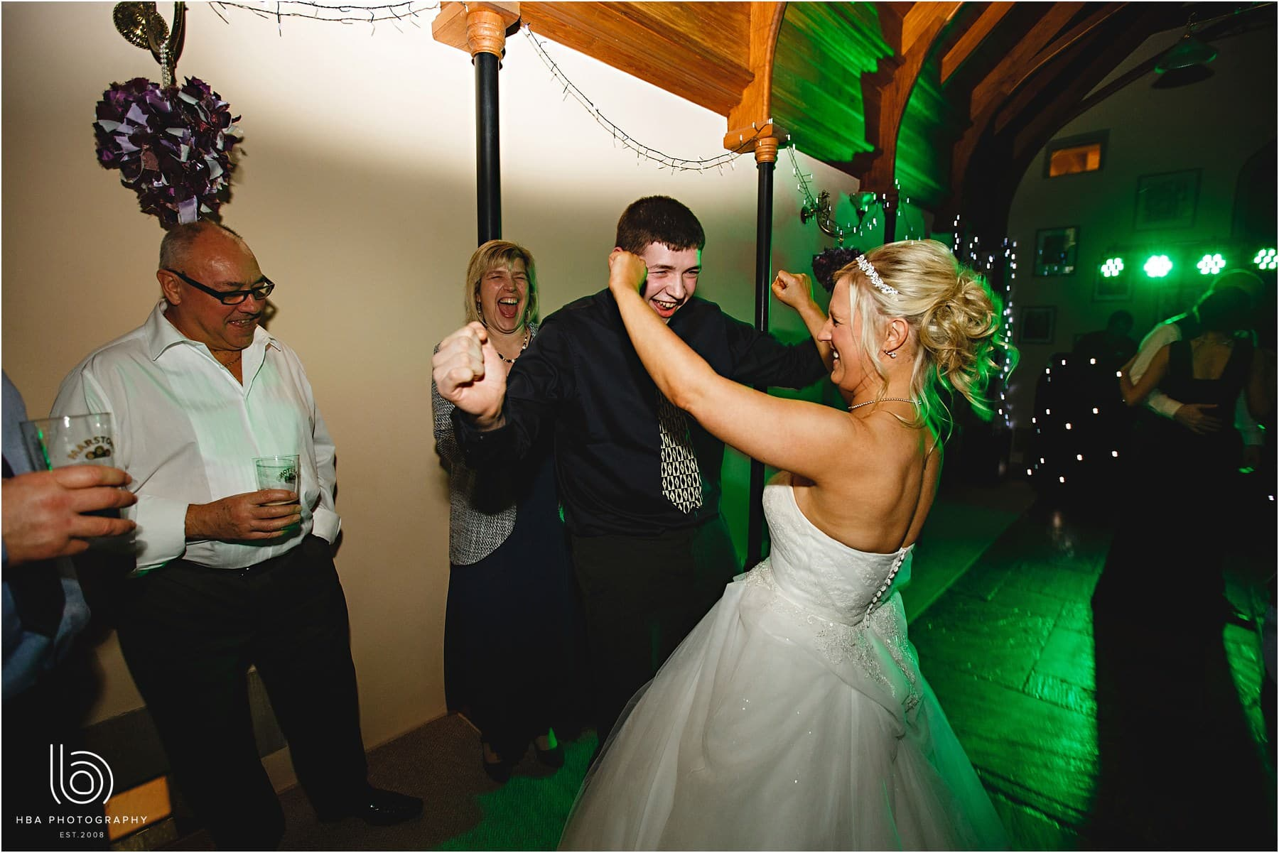 The bride dancing with wedding guests