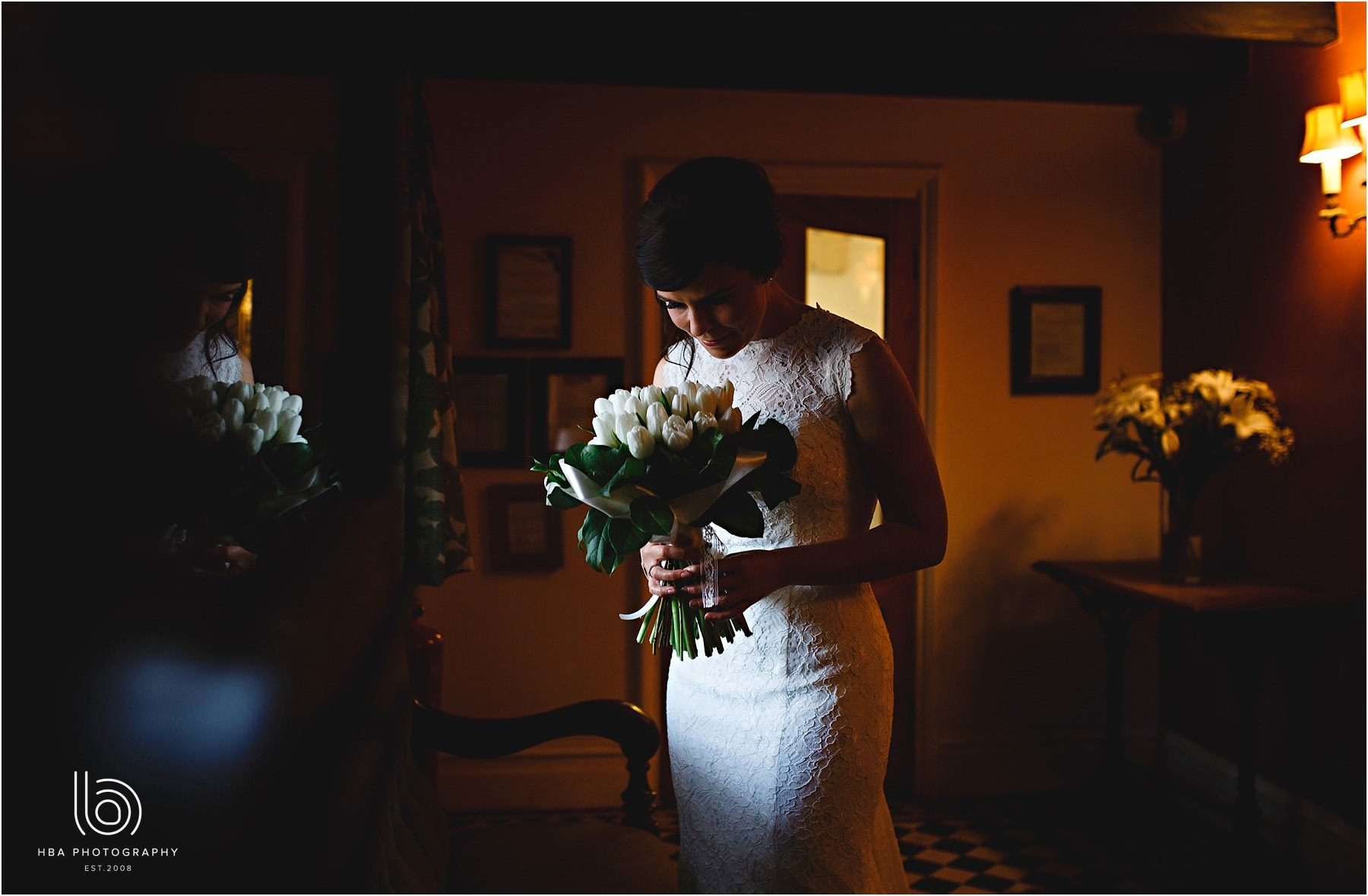 The bride at Donnington Park farmhouse holding her flowers