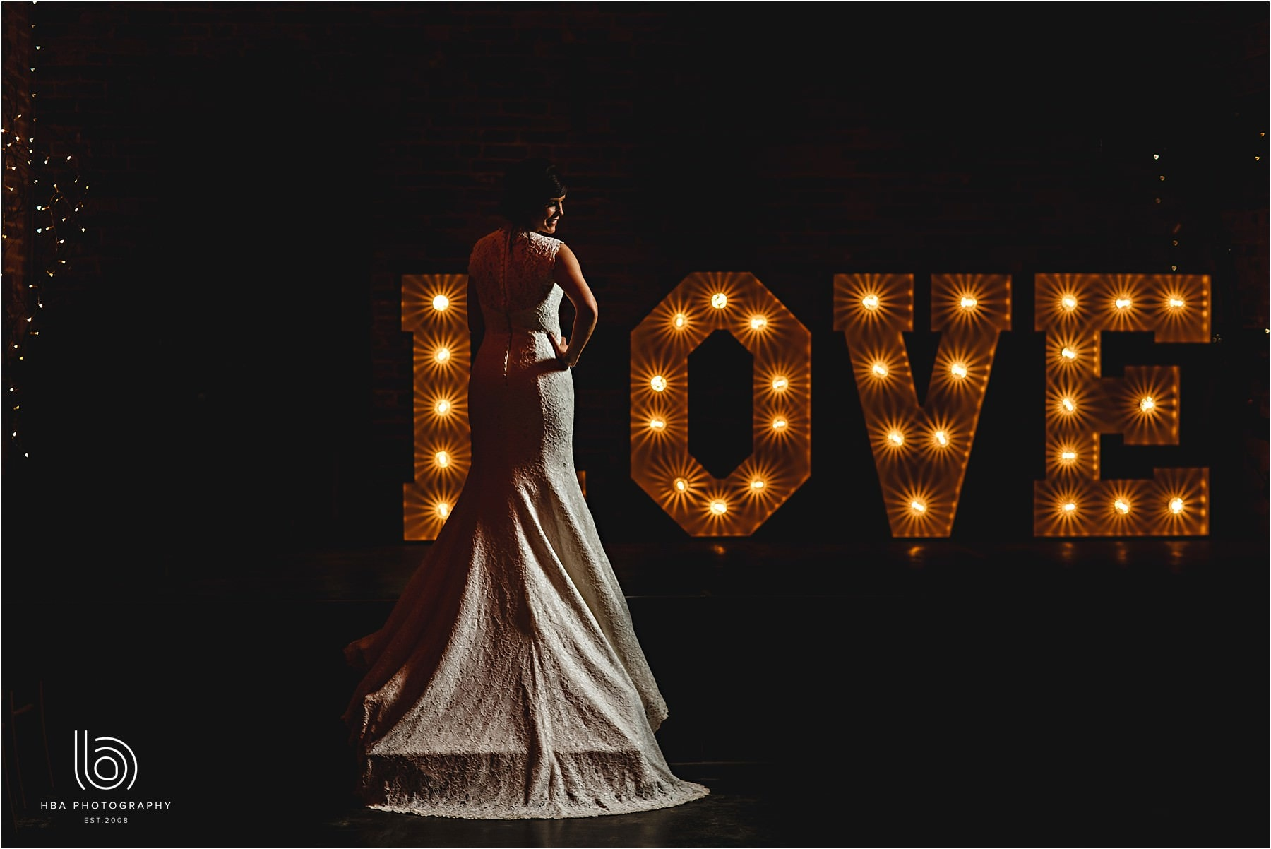 The bride to stood showing her dress with love letters
