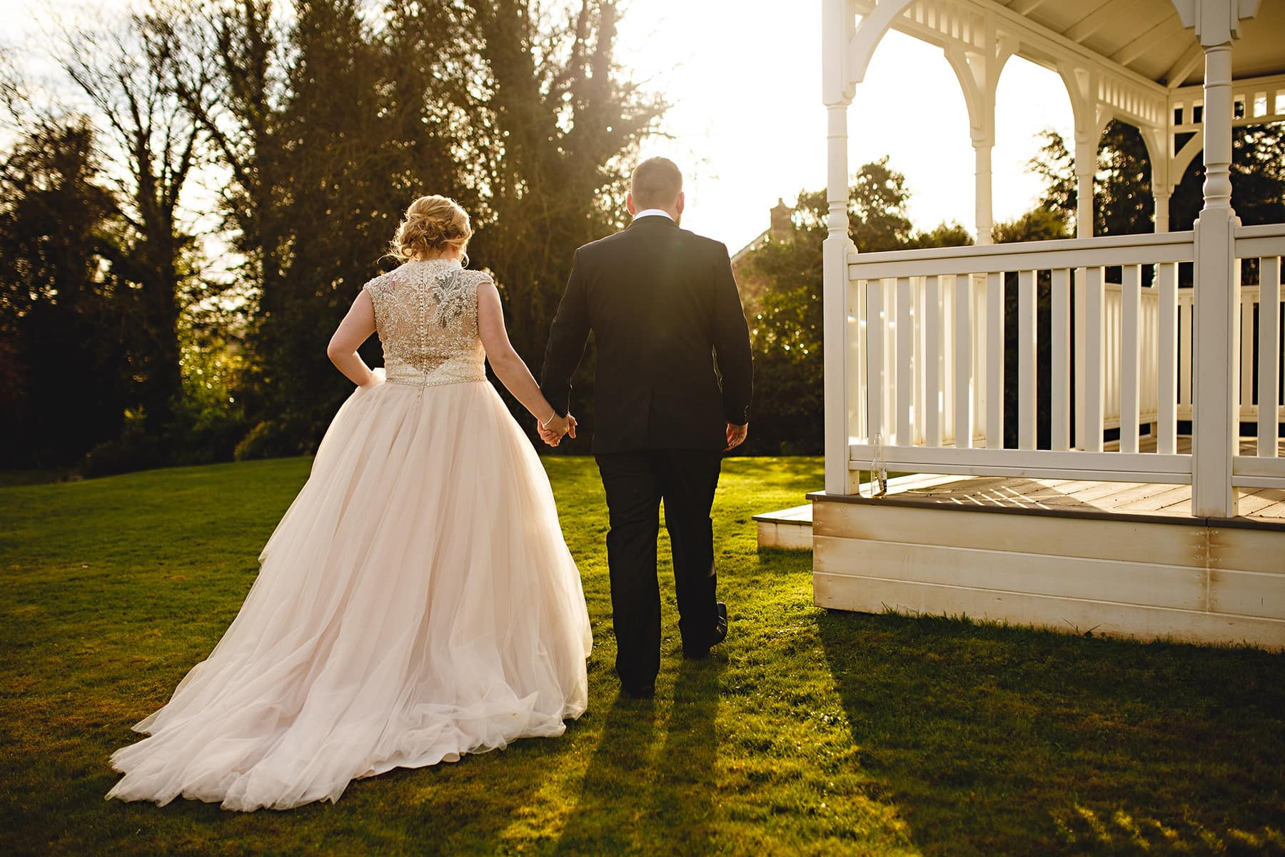 The bride and groom walking into the sun at The Old Vicarage in Southwell