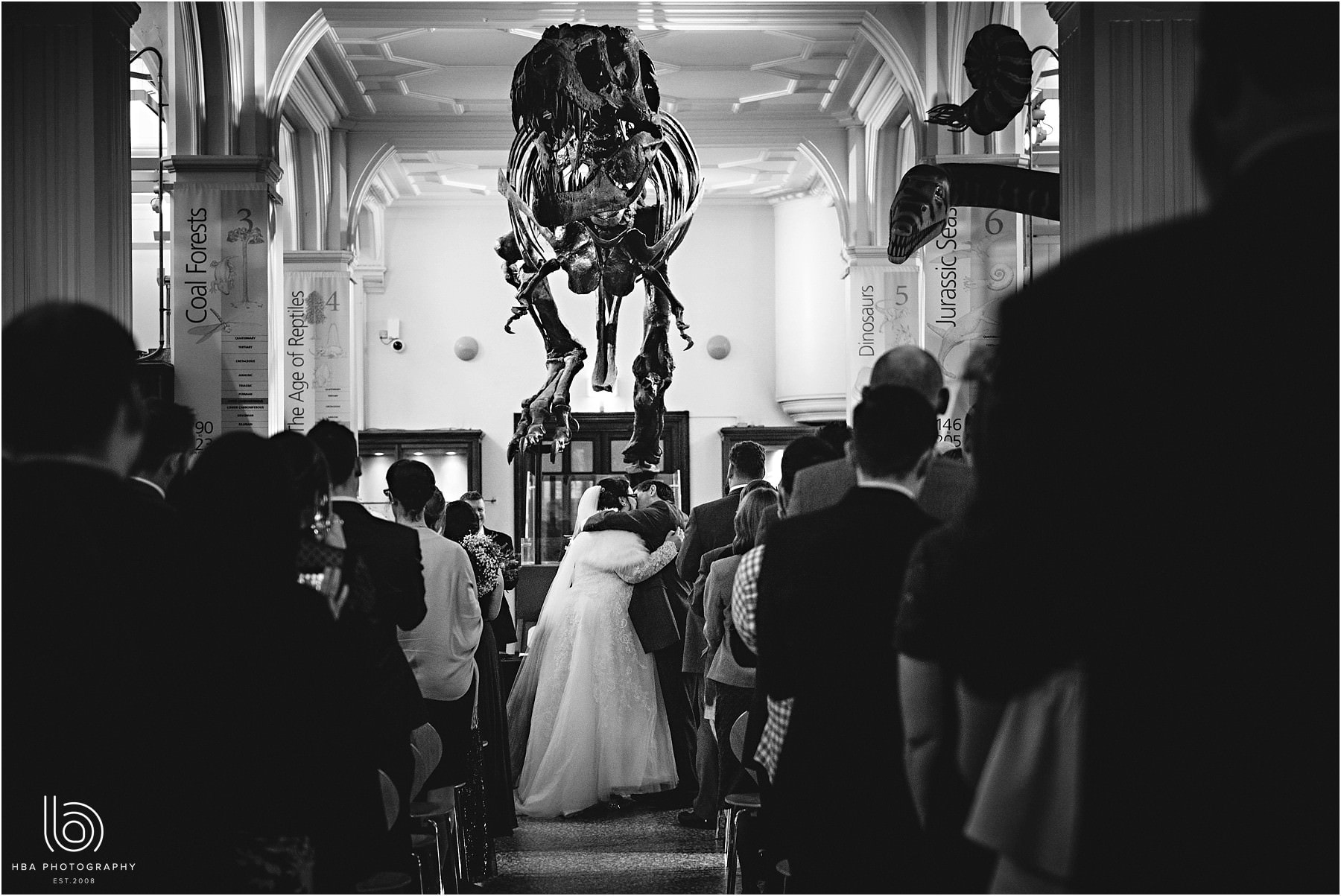 the bride & groom with the dinosaur