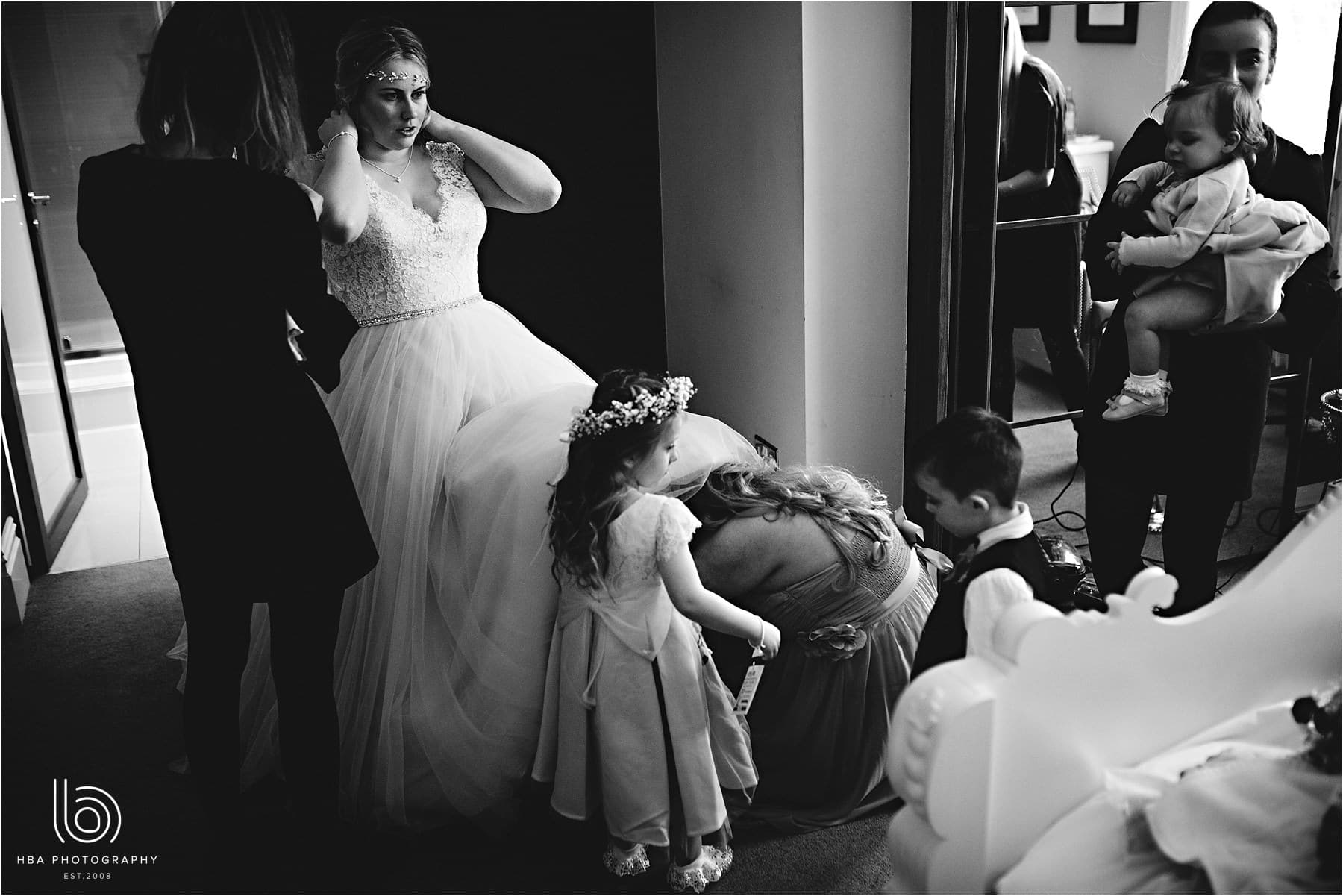 the bride putting her dress on