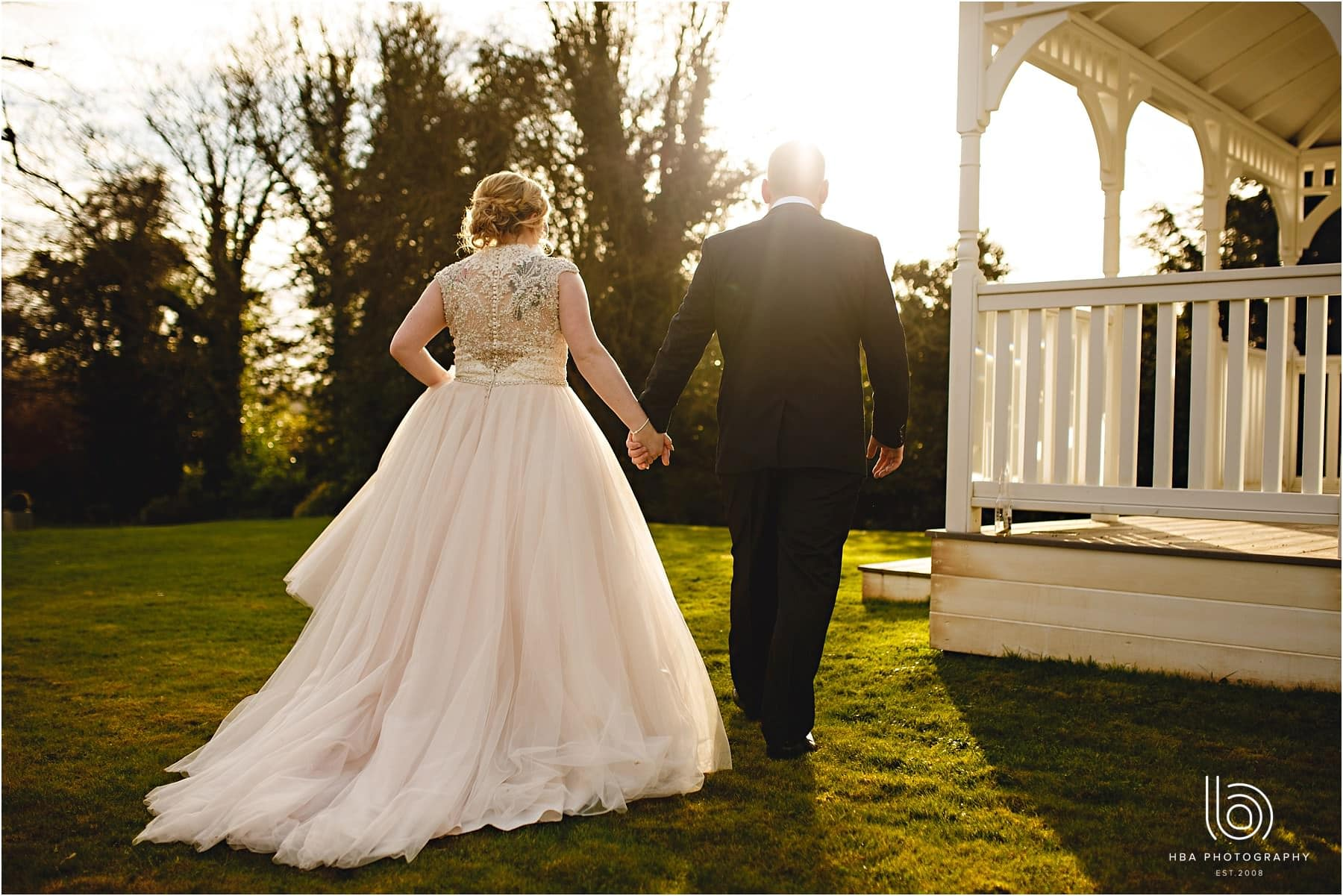 the bride & groom in the sunshine at The Old Vicarage