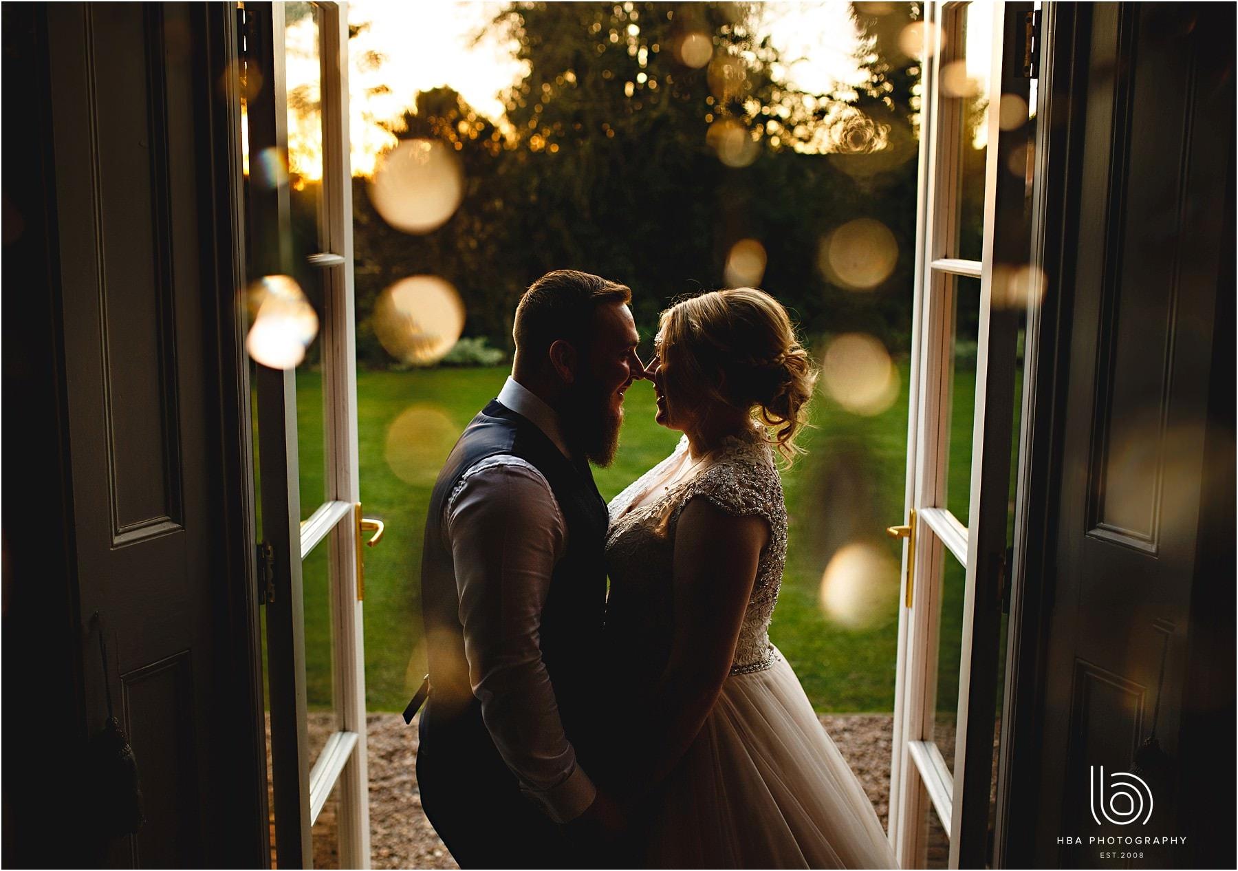 the bride & groom in the doorway