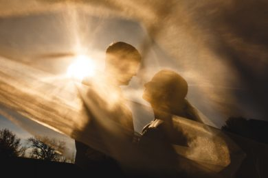 The bride and groom in an orange sunset