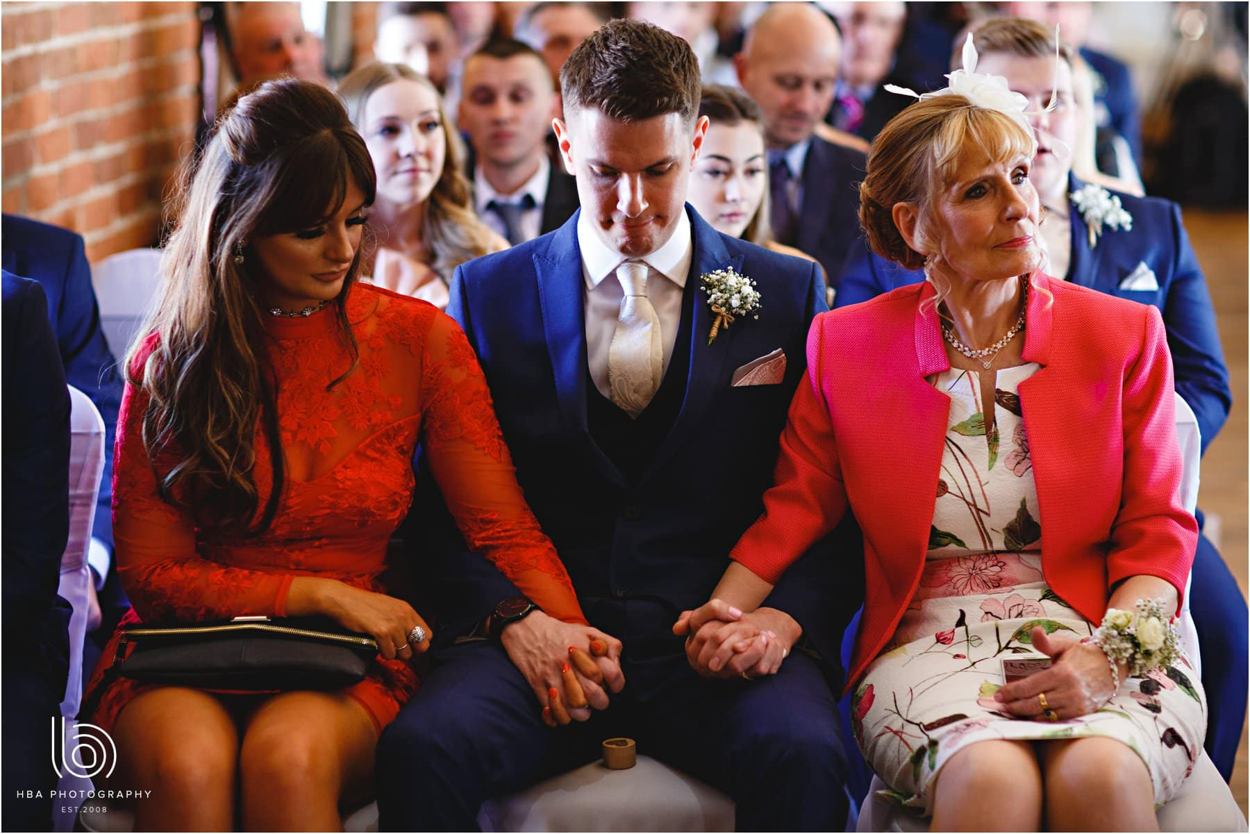 the family holding hands during the ceremony