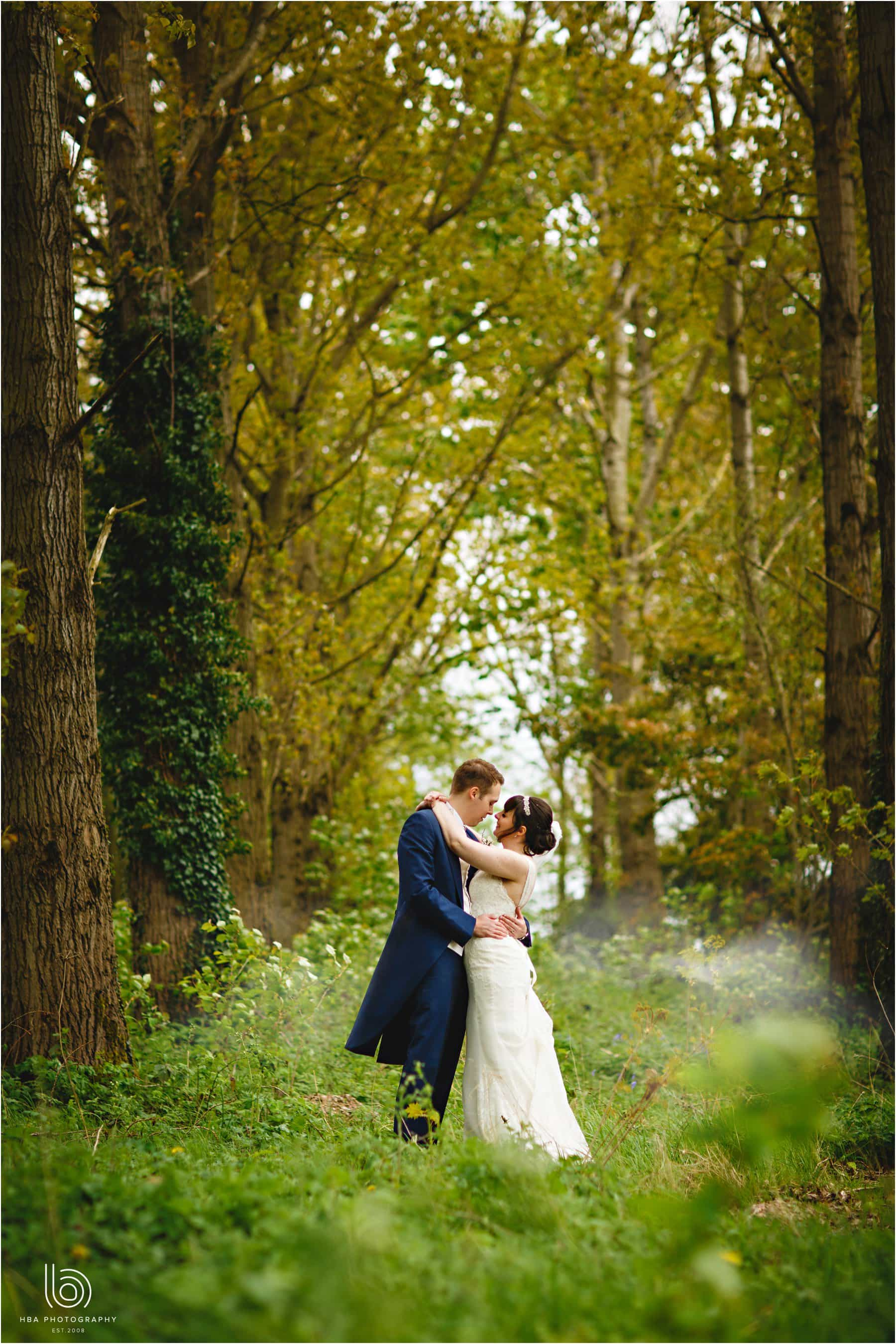 the bride and groom in the woods