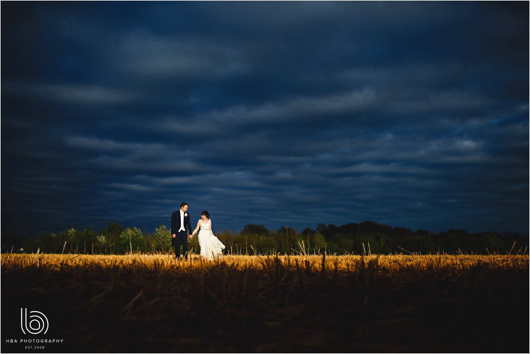 the bride and groom in stormy skies