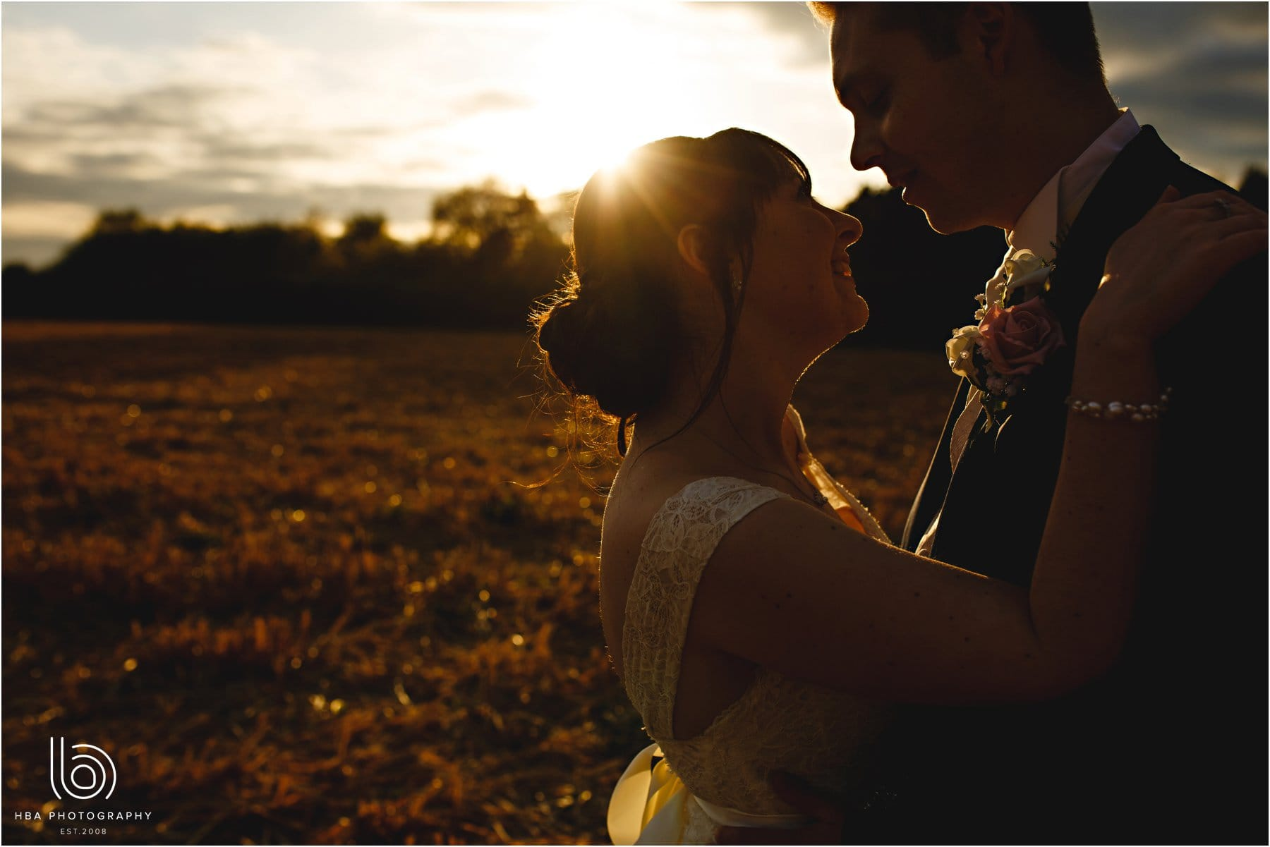 the bride and groom in the golden hour sun