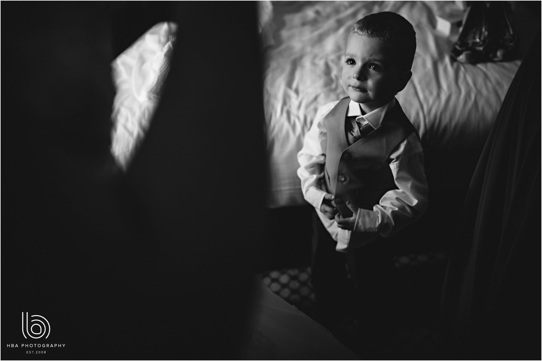 the bride's son watching his mum get ready for the wedding