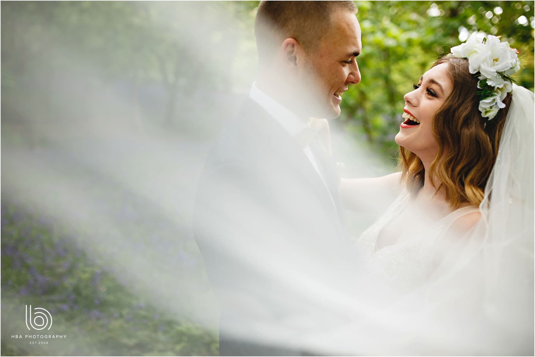 bride and groom together laughing