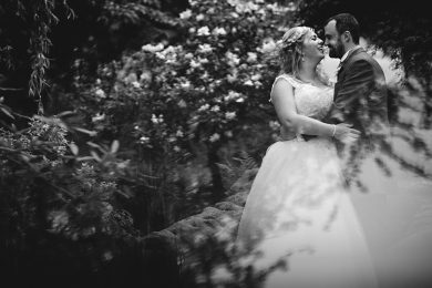 the bride and groom in the gardens at Breadsall Priory in Derbyshire