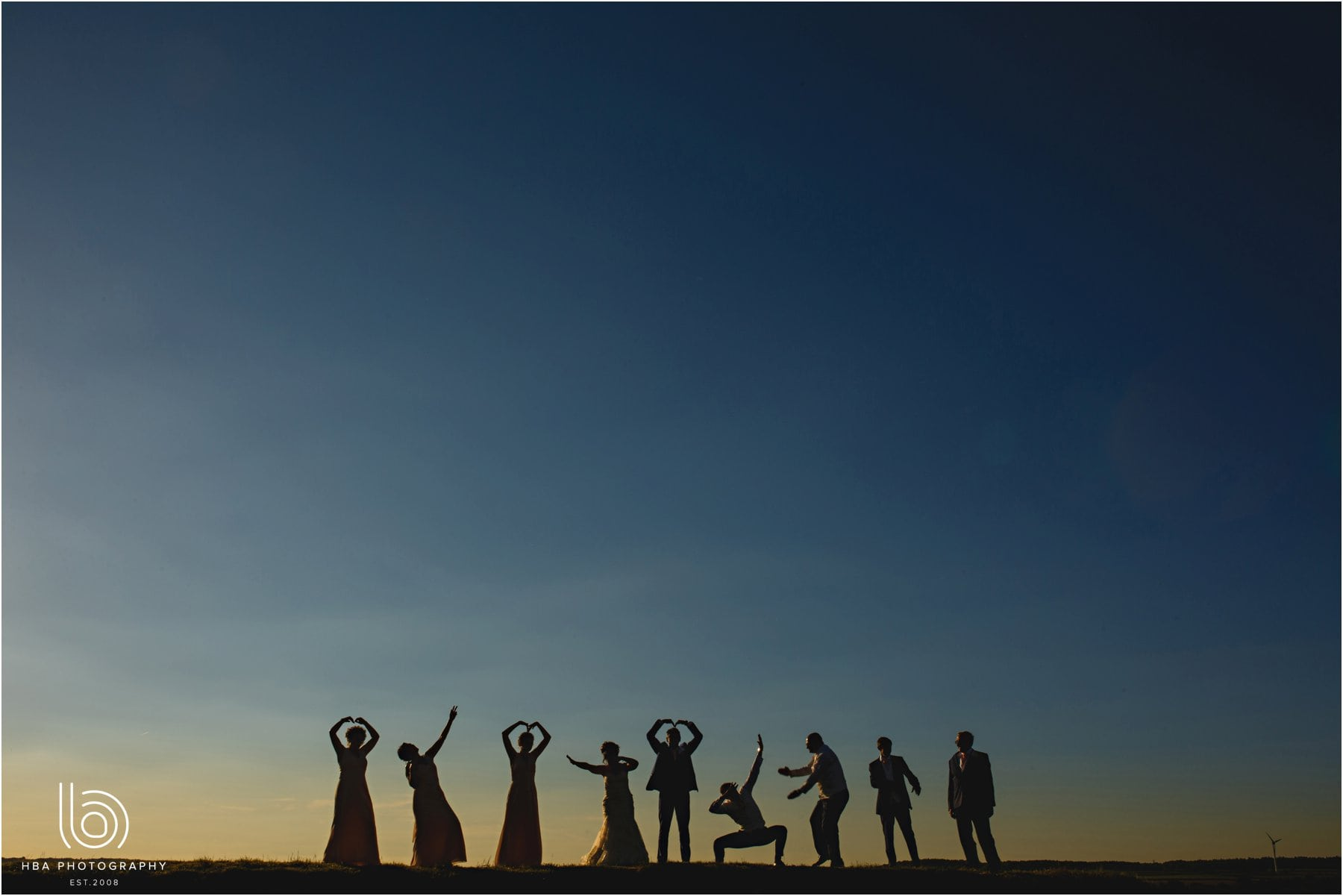 the bridal party of the horizon in silhouette
