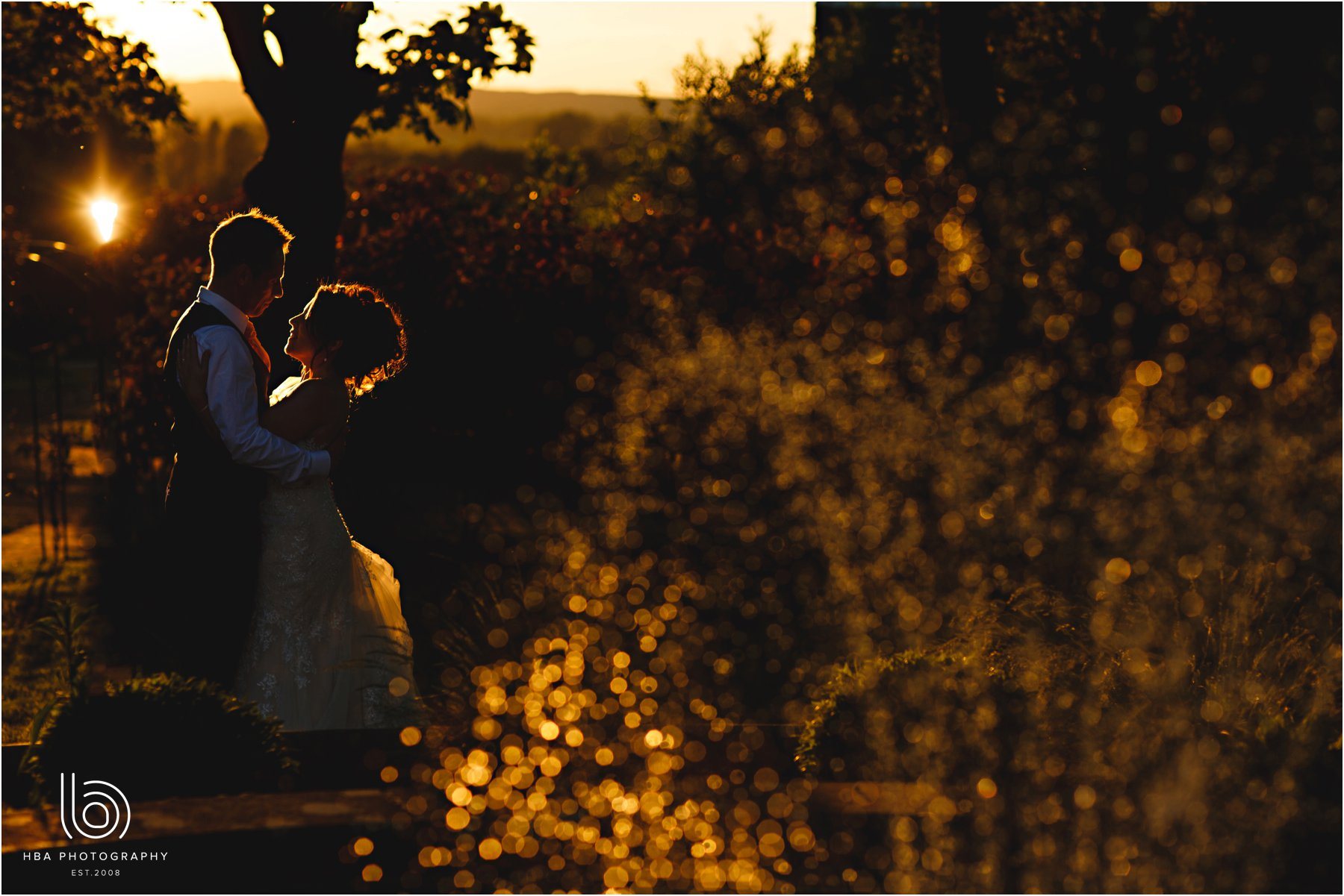 the bride & groom in the golden hour sun