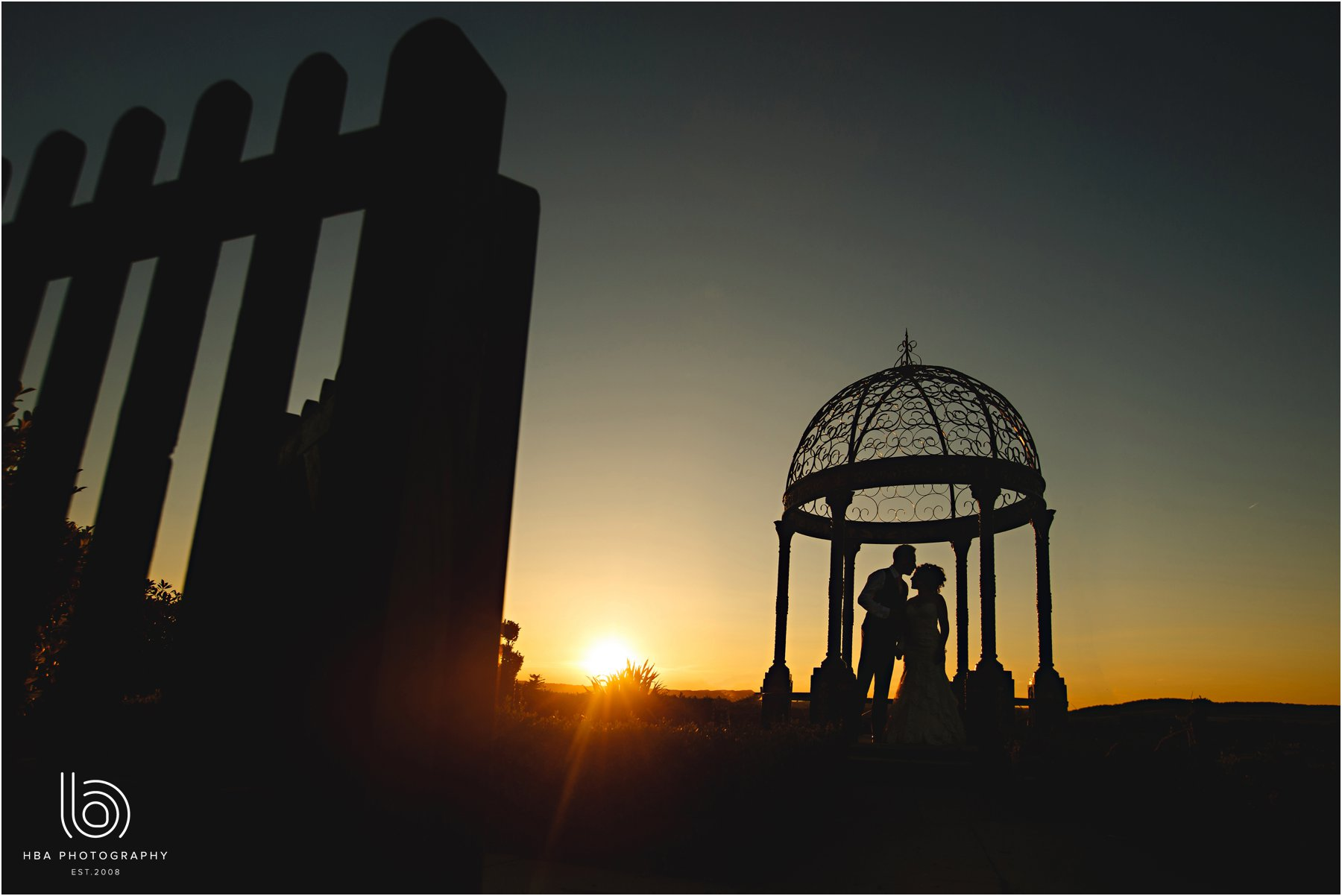 the bride & groom in silhouette
