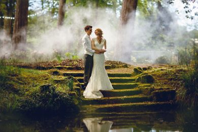 the bride and groom stood in the woods at Hogarths on their wedding day