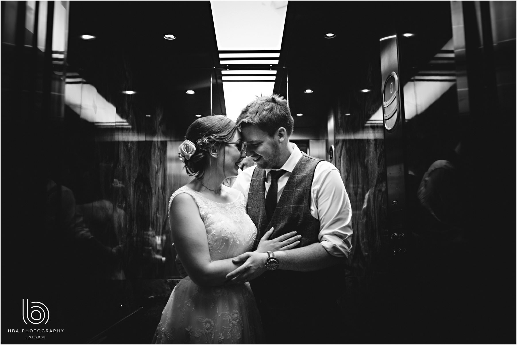 the bride & groom in the lift
