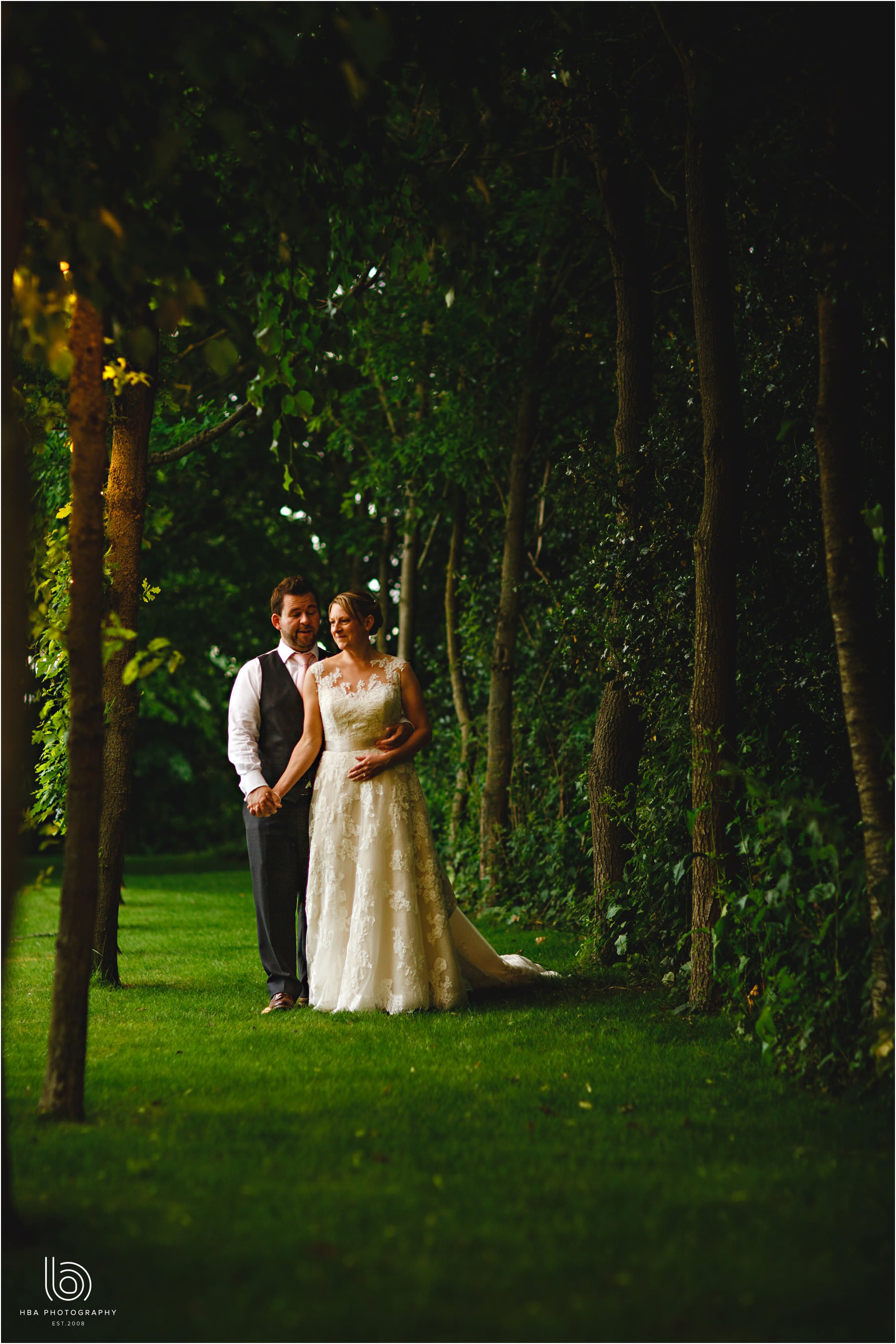 the bride & groom in the trees